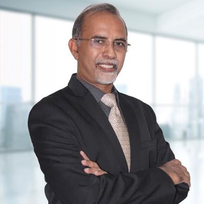 Associate Professor Dr.Varughese K.John, PhD, MBA, MPhil, MCom, LLB.